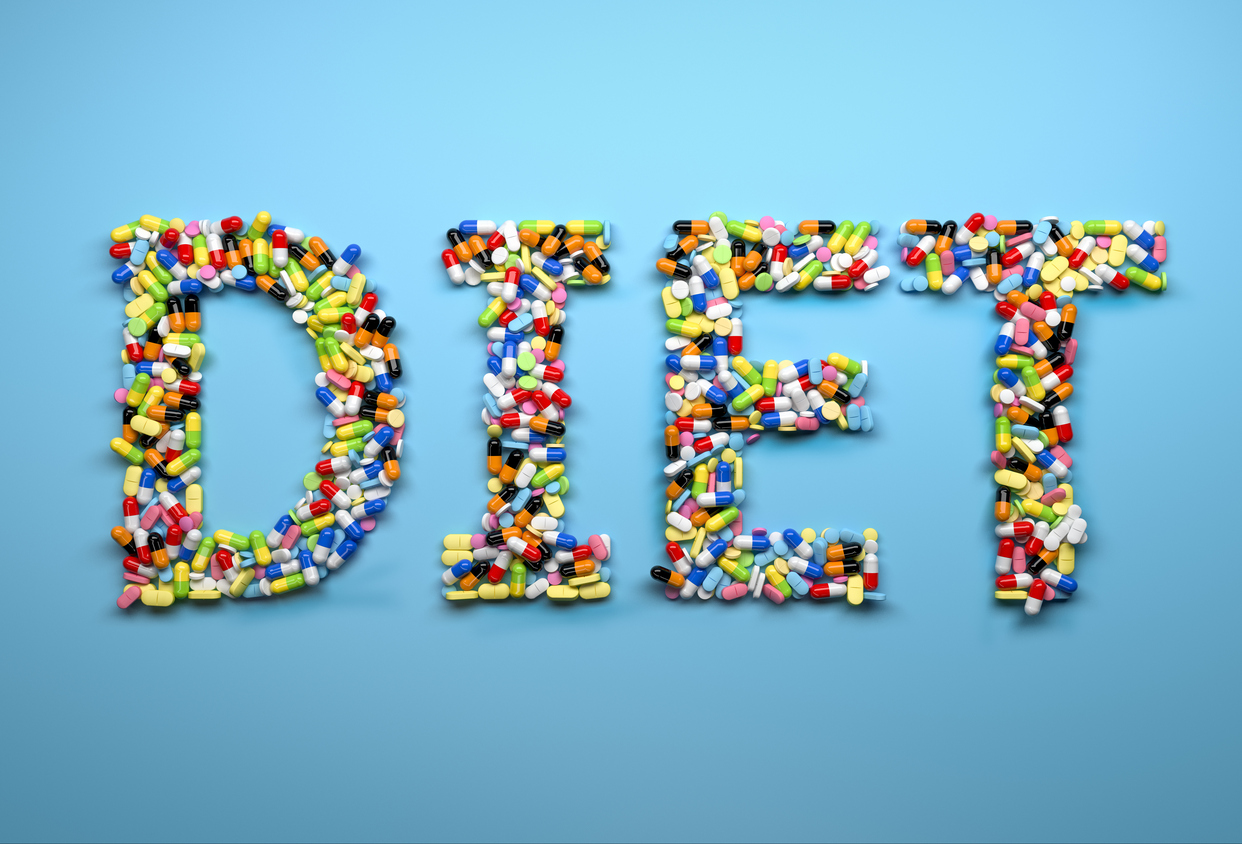 The word diet spelled out with supplements