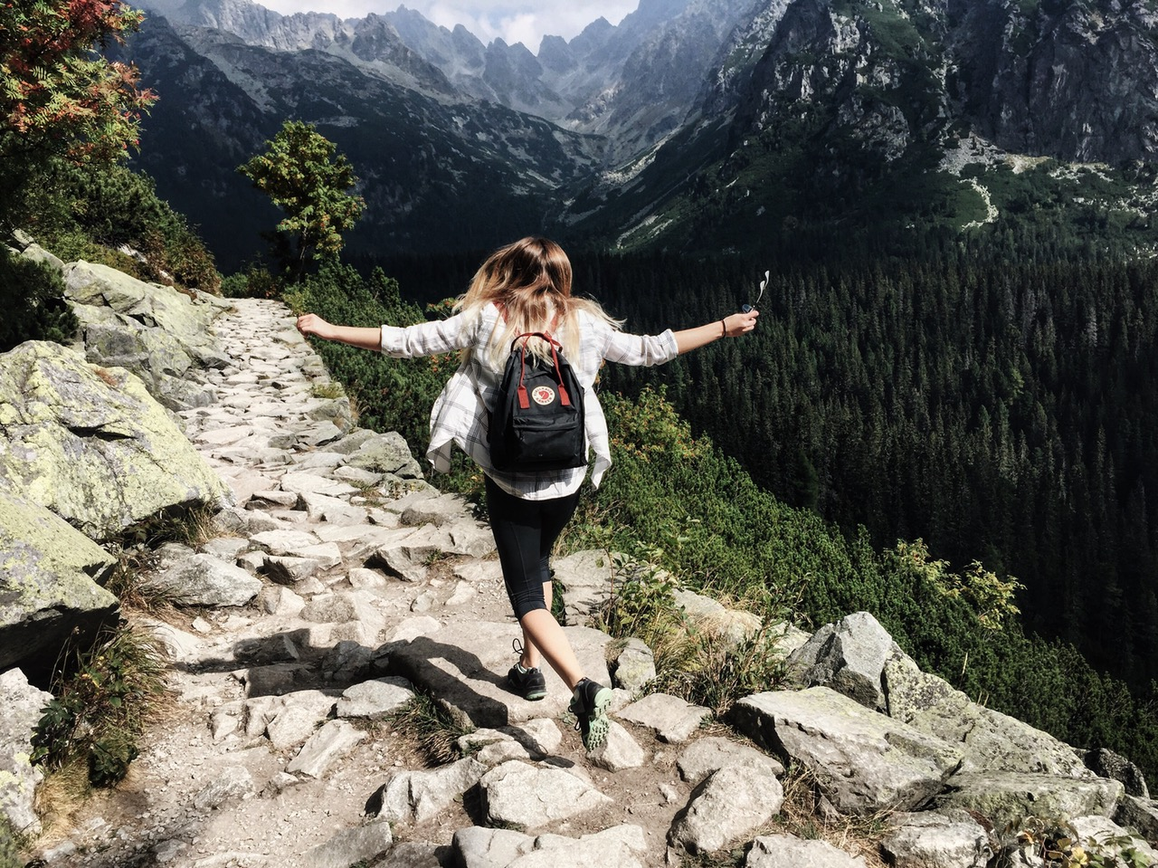 A healthy happy girl hiking